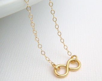 tiny gold infinity necklace. small 14k gold filled. 14 k simple sweet everyday jewelry. dainty delicate pendant.gift for women. her 1/2""