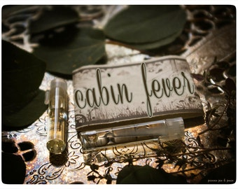 cabin fever - natural perfume oil mini sampler twin pack - primary notes: juniper woods, clinging vines, wild flowers