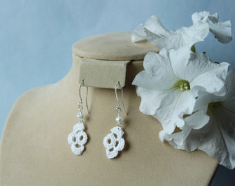 Half bloom crochet dangle earrings, with pearl.
