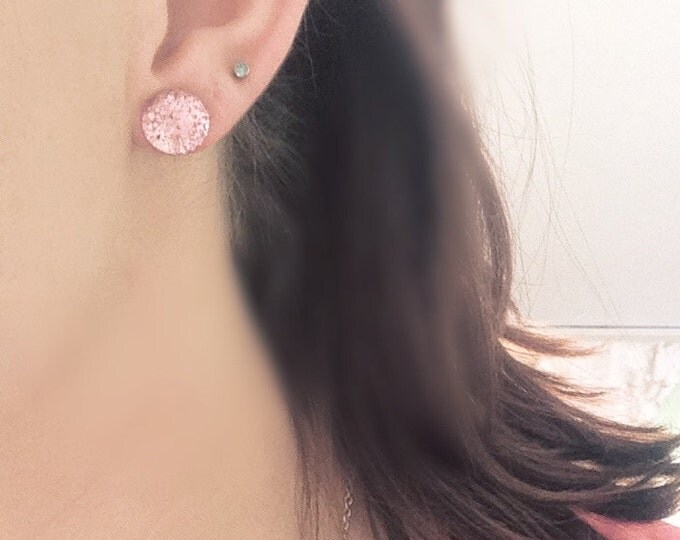 Pink bubble post stud earrings.