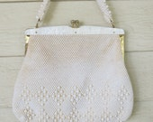 white beaded purse with pearly lucite