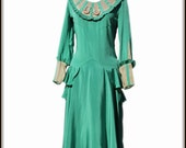 1920s Green Flapper Dress with Ruffles, Peplum, Accordion Pleating and Ribbon Roses detailing.