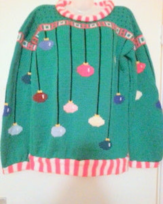 Knitting Pattern Christmas Cardigan : Knitting pattern Arthur Christmas Sweater in adult sizes.