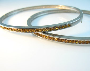 Topaz Rhinestone Bracelets. Set of Two. Hinged Oval Bangles. Channel Set Golden Crystals. Vintage 1980s Art Deco Style Jewelry