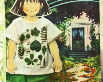 Linnea In Monet's Garden Paper Doll with Fabric Doll Clothes