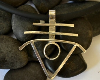 "Sterling silver modern pendant with 4mm cord.  ""outer limits"""