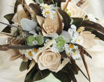 Rustic wedding bouquet. Country garden bush inspired bouquet.  Feathers, wildflowers, foliage and sola (wood) flowers.