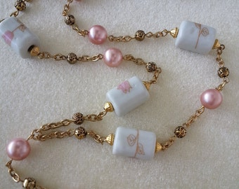 """ID Lanyard, Name-tag Holder.  Painted proceline and pink pearl  beads.  36"""""""