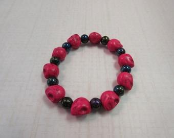 Red howlite and black beaded skull bracelet.