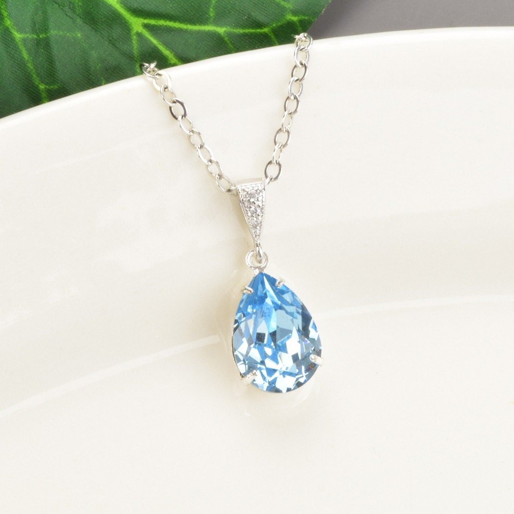 Aquamarine Necklace Swarovski Crystal Pendant Necklace. Knot Pendant. Onyx Pearls. French Back Earrings. Screw Bangle Bracelet. Gem Bracelet. Patina Platinum. Non Traditional Engagement Rings. 6 Prong Engagement Rings