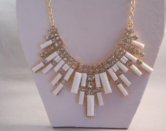 Bib Necklace with Gold Tone, White and Rhinestone Pendants on a Gold Tone Chain