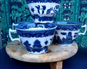 5 tea cups willow blue and white transfer ware.unusual shape.