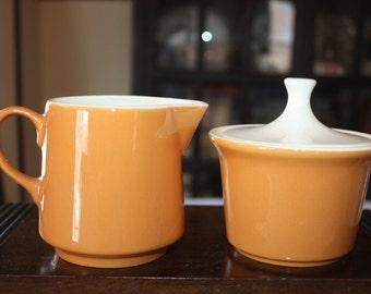 Midcentury creamer and sugar in retro orange-butterscotch color