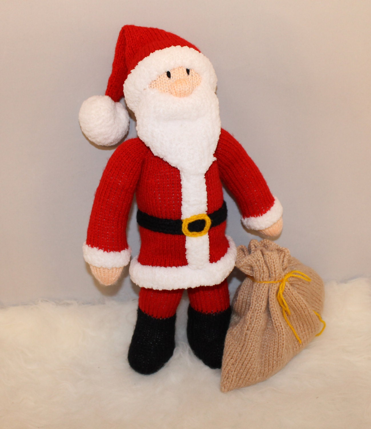 Toys From Santa : Santa claus with two toys in his bag father christmas