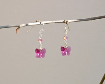 Earring set with bright pink butterflies and round Swarovski cristals, glass and grey beads and silver platted elements