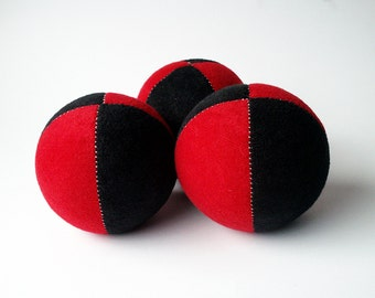 Set of 3 handmade, 2.5inch juggling balls with packaging and instructions in red&black