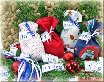 Advent calendar with embroidered numbers, 24 little bags in blue, white, green