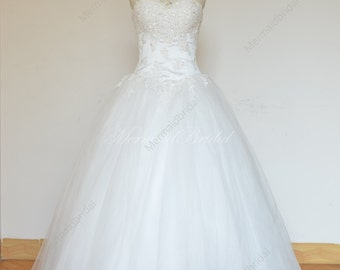 Romantic Ivory ball gown wedding dress with elegant beading work
