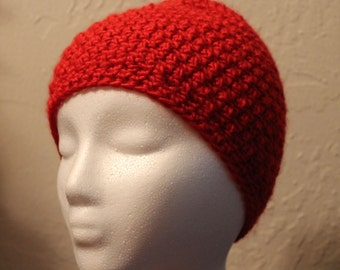 Red crocheted hat.