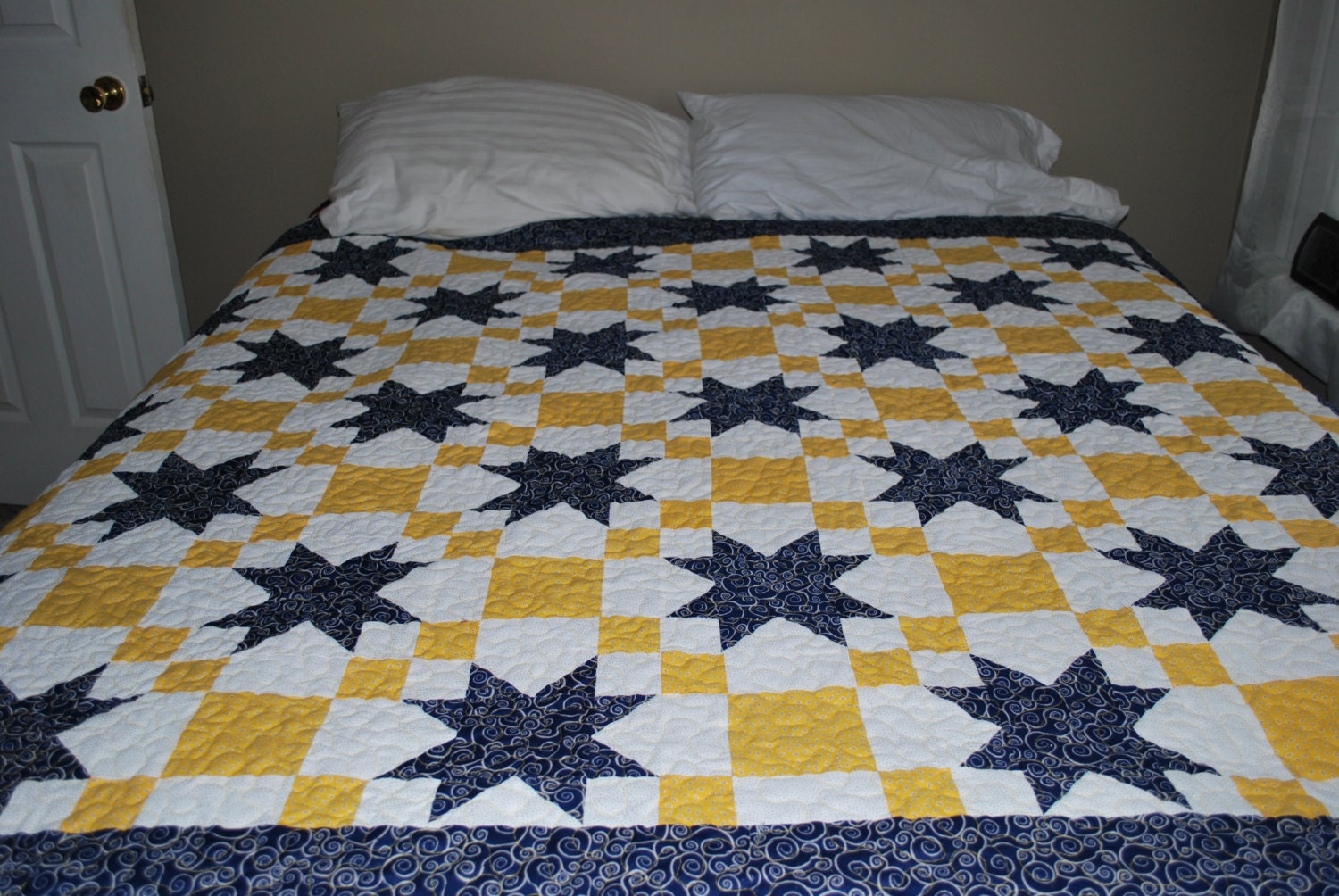 [ navy and yellow quilt ]