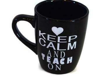 "Vinyl ""Keep Calm and Teach on"" mug, Black mug white vinyl"