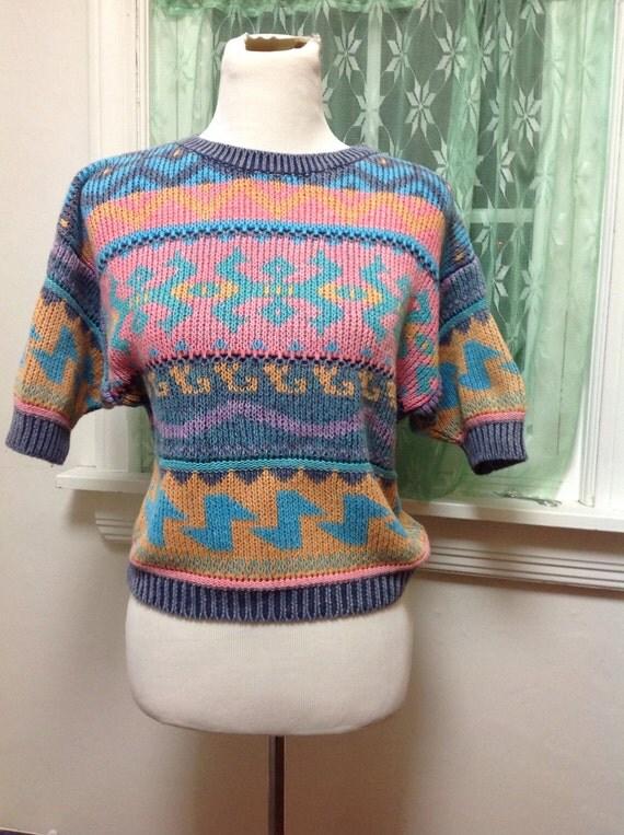 Velvety Sweater Material Crossword Clue 53
