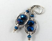 Cobalt Blue Faceted Glass Framed in Tibetan Silver crafted oval bead frame. Sterling Silver Plated Lever-back Earrings.  JemstoneZ