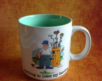 """Golf mug by Jim Benton made by Papel """"anything to lower my handicap"""""""