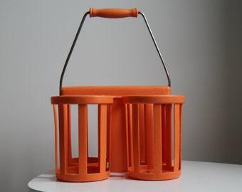 Orange plastic bottle holder for 4 bottles.