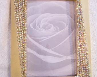 Gold Tone Photo Frame covered in Clear and Aurora Borealis Rhinestones.