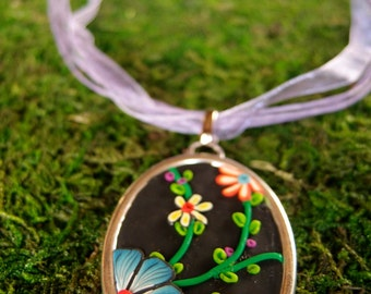 Polymer clay Medallion necklace oval climbing flowers.