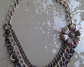 Mixed metal multistrand chain necklace with detachable flower.