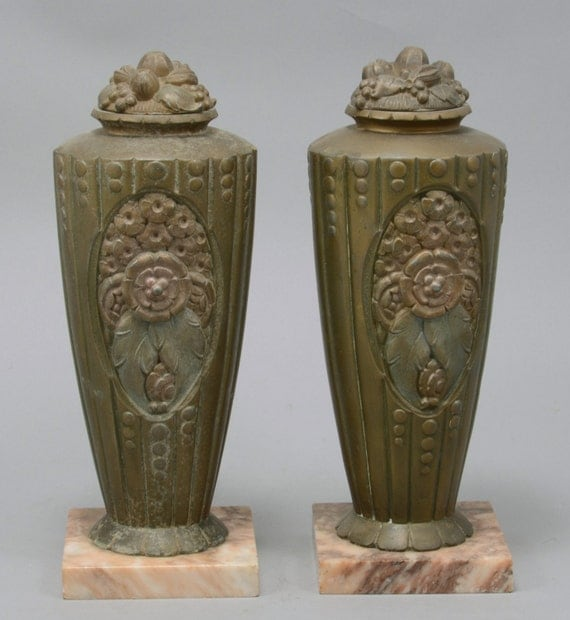 pair of deco style antique vases with marble base