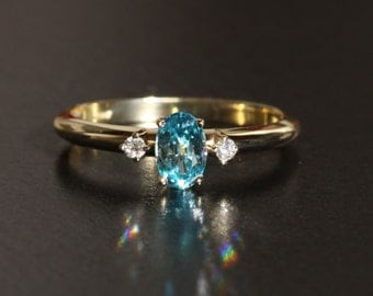 14K Yellow Gold .4 CTTW Genuine Diamond & Blue Zircon Ring with 6.00x04.00 MM Faceted Oval Genuine Zircon, .43 carat