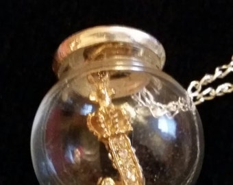 reworked juicy couture'J' suspended in a glass orb on  a 6 1/2 inch silvertone chain.  A ONE OFF