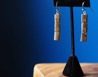 Wonderful married metals earrings hand-crafted in Taxco, Mexico. Silver, copper, and bronze.