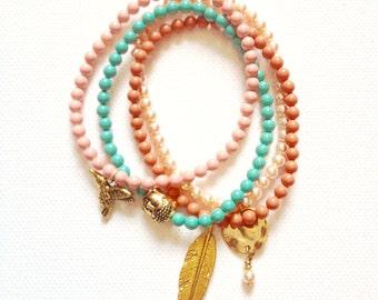 Pearl Elastic Charm Bracelets (Buddha, Bird, Feather & Disc Charms) using Swarovski Elements Pearls