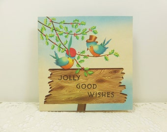 Jolly Good Wishes, Two Bird with Holly on Signpost, Merry Christmas 1950s Rynart Used Christmas Card