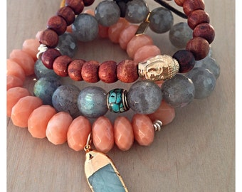 Rosewood stretch bracelet with 24k over brass Buddha bead