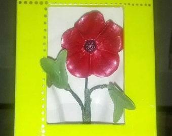 Fimo poppy in a porcelain frame