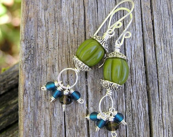 earthy bohemian style dangle earrings with glass beads and smoky quartz gemstones. rustic tribal earrings. green, blue, brown colors.