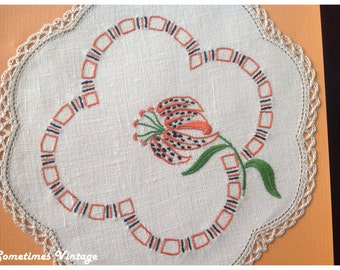 Hand Embroidered Doylie with Tiger Lily Design. Crochet Edging.
