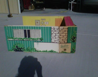 1960 Barbie Dream house with moveable  cardboard furniture.