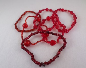 6 Stretch Red Bracelets