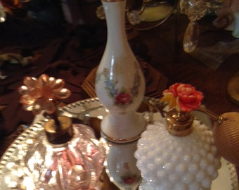 Pretty Pink Irice perfume bottle jeweled top