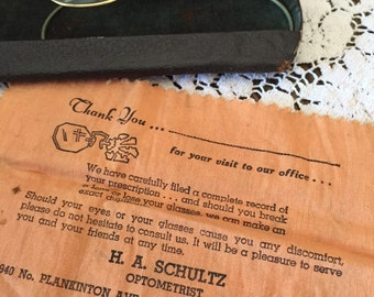 Wire framed glasses with case and lens cloth.  Optometrist HA Schultz from Milwaukee, Wi