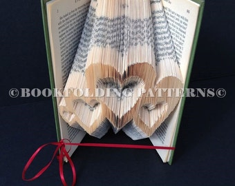 4 mixed sized hearts book folding pattern