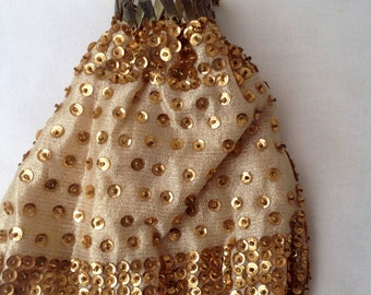1960's vintage accordian style gold coloured bag