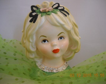 """Collectible LADY HEAD VASE 5.75"""" tall A Blonde Girl wearing Green, White, Gold, Blouse Flowers Trimmed in Black Ribbon in her Hair"""