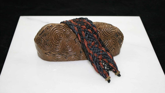 Leather Celtic bracelet in blacks, blues, and browns